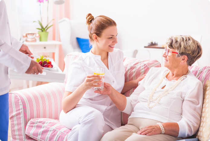 caregiver talking to her old patient